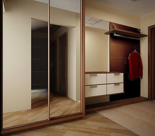 зеркальная поверхность мебели в прихожей