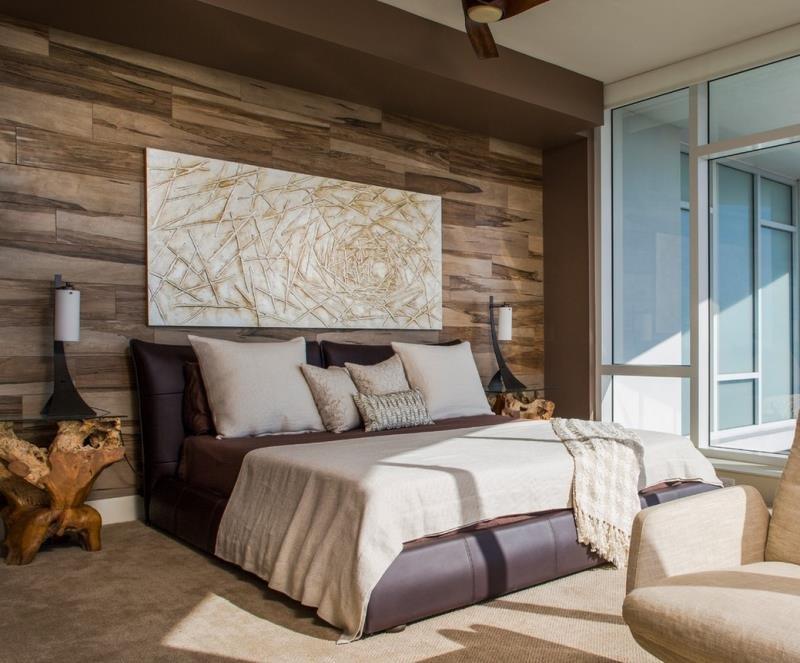 Настенный ламинат в современной спальне