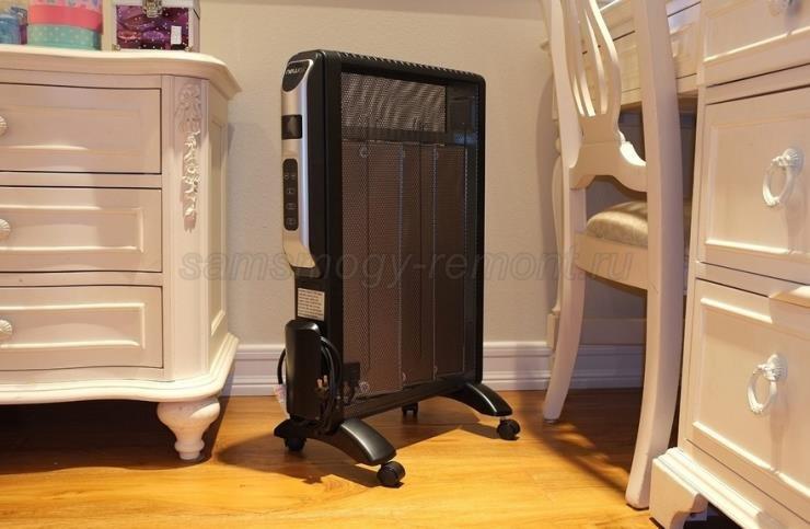 Масляный радиатор в интерьере маленькой комнаты